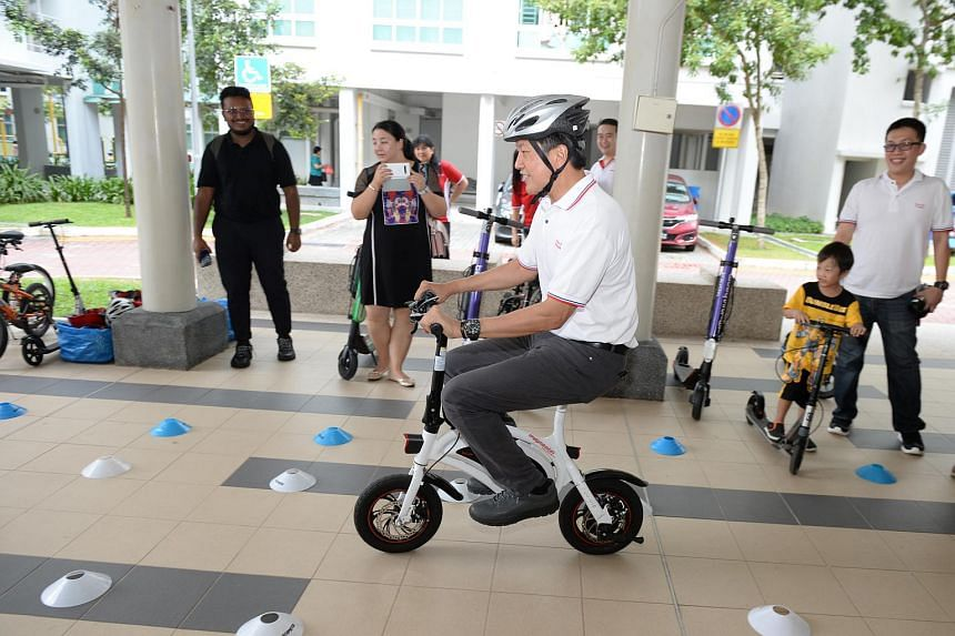 Minister in the Prime Minister's Office Ng Chee Meng participating in a safe-riding programme activity at the Buangkok Fun Carnival on July 7, 2019.