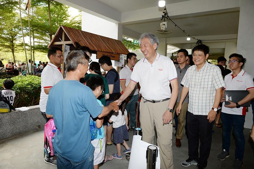 Senior Minister Teo Chee Hean greeting residents at the Buangkok Fun Carnival on July 7, 2019.