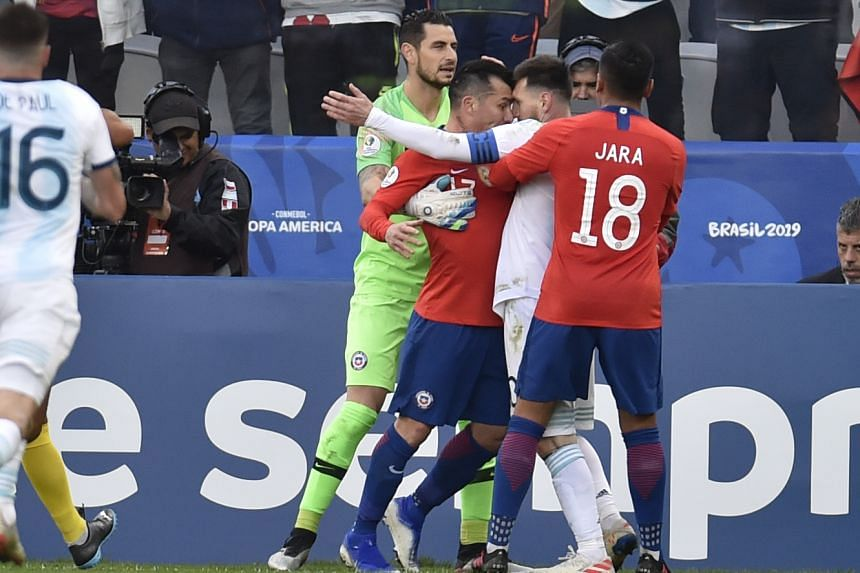 Chile's Gary Medel (second left) and Argentina's Lionel Messi argue before being sent off.