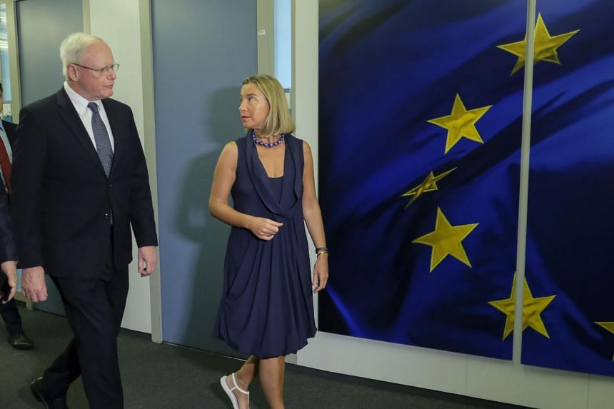 US special envoy for Syria and the anti-ISIS coalition James Jeffrey (left) walks alongside European Union foreign policy chief Federica Mogherini ahead of their meeting in Brussels on June 28, 2019.