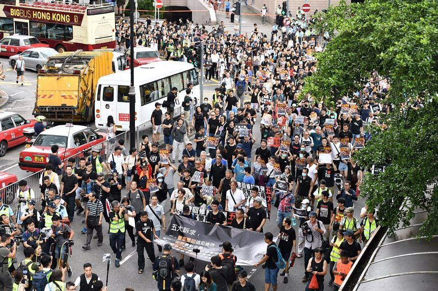 Hong Kong protesters march from Salisbury Garden on the afternoon of July 7, 2019.