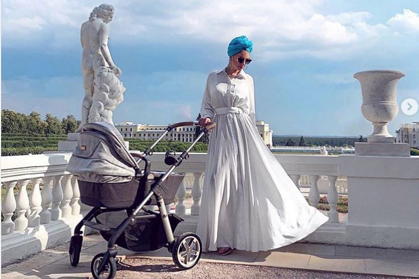 Ms Voevodina with her son's pram in a candid post about her fears as a new mother.