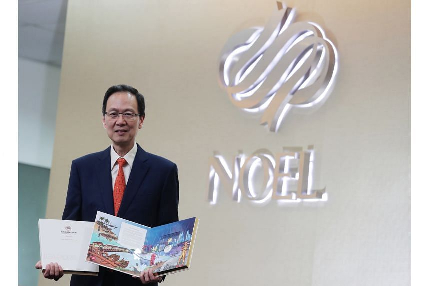 Mr Alfred Wong, managing director of Noel Gifts International, with the company's medallion set collection, a project in support of the Singapore Bicentennial. It is part of a thematic nine-book collection that tells the story of Singapore's transformatio