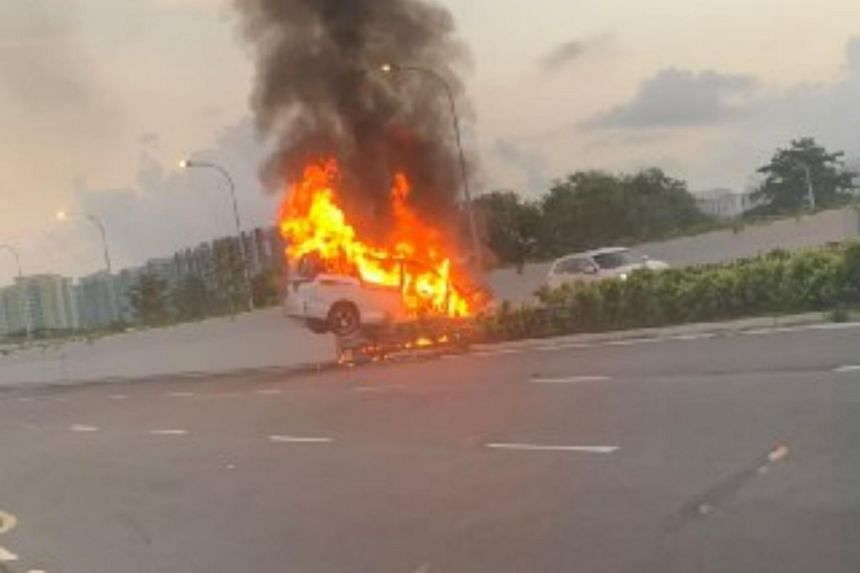 Photos on Telegram group SgRoad Blocks show the car engulfed in flames, with plumes of smoke billowing out of it.