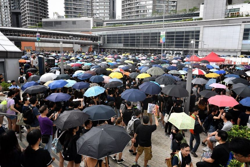 Protesters gather at the West Kowloon railway station in Hong Kong as rain fell on July 7 afternoon.