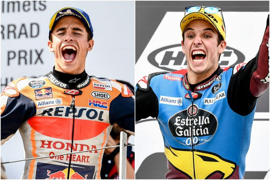 Marc Marquez (left), who snagged his seventh consecutive victory having earlier seen his younger brother Alex (right) win the Moto2 race.