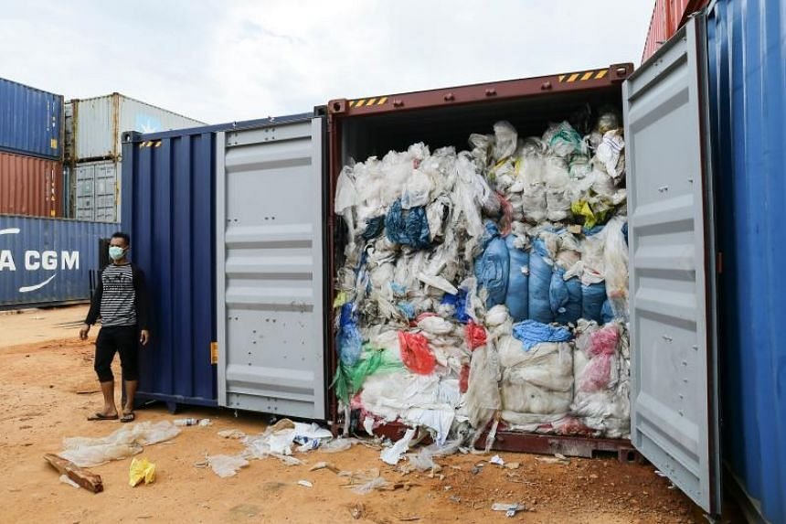 A container filled with imported plastic rubbish undergoing inspection by the local environment office in Batu Ampar port in Batam, on June 15, 2019.