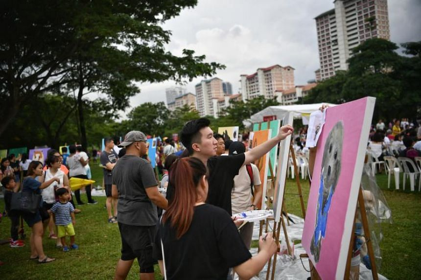 People painting at the PAssionArts Festival on July 7, 2019.