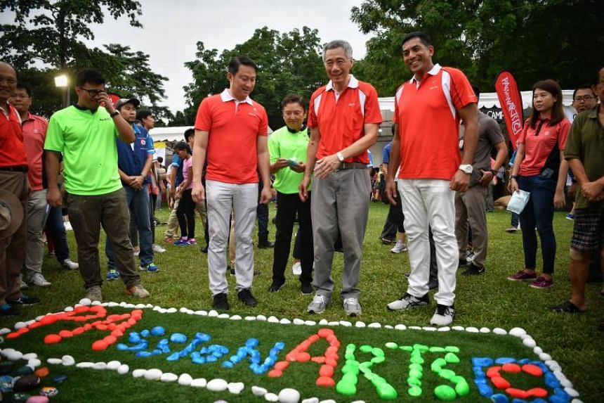 PM Lee Hsieng Loong (centre), with Senior Minister of State for Transport and Health Lam Pin Min and Ang Mo Kio GRC MP Darryl David at the PAssionArts Festival, on July 7, 2019.