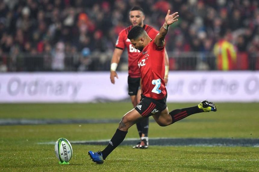 Crusaders' Richie Mo'unga kicks a penalty during the Super Rugby final match between New Zealand's Crusaders and Argentina's Jaguares in Christchurch on July 6, 2019.