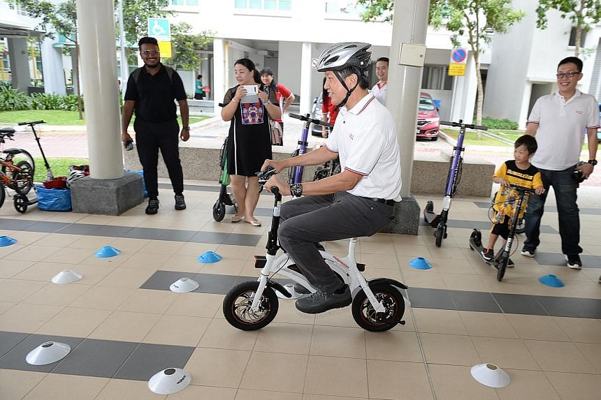Minister in the Prime Minister's Office Ng Chee Meng taking part in a safe-riding activity at the Buangkok Fun Carnival yesterday. PHOTO: LIANHE ZAOBAO