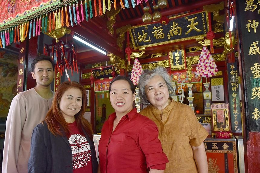 Singapore Heritage Society executive director Chua Ai Lin (second from left) with researchers (from left) Fauzy Ismail, Lynn Wong and Vivienne Wee at Seng Wong Beo, a temple in Tanjong Pagar.