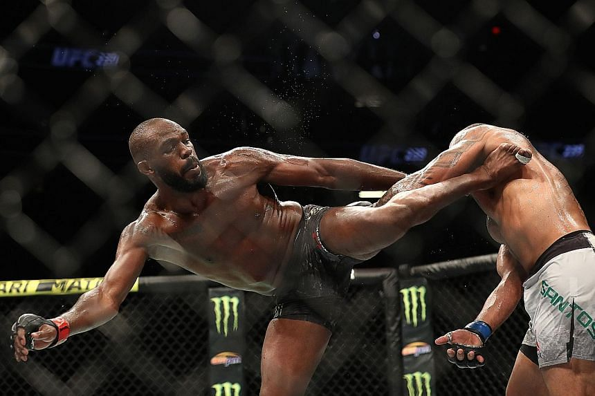 """American MMA star Jon Jones kicking Brazilian Thiago Santos during their UFC title bout at T-Mobile Arena in Las Vegas on Saturday. Jones, who turns 32 on July 19, says if his body holds up, he would like to keep fighting for """"another two to four yea"""