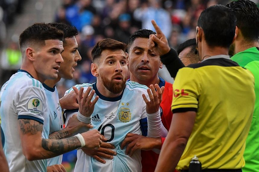Argentina's Lionel Messi complaining to referee Mario Diaz de Vivar after he and Chile's Gary Medel (out of frame) were sent off in the third-place play-off on Saturday.