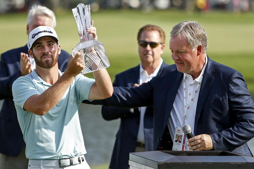 Matthew Wolff (left) receiving his trophy from 3M vice-president Jeff Lavers after winning the 3M Championship golf tournament at TPC Twin Cities on July 7, 2019.