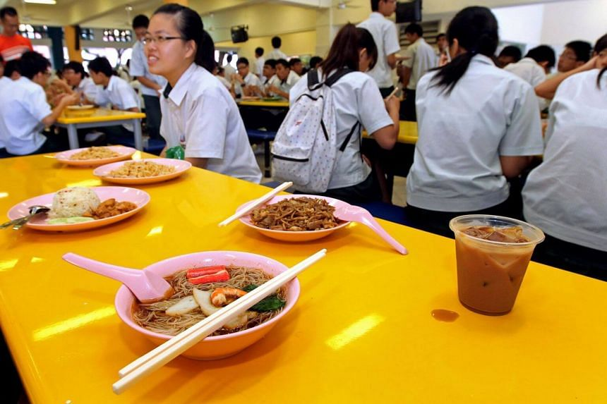Students having their meals in the school canteen.