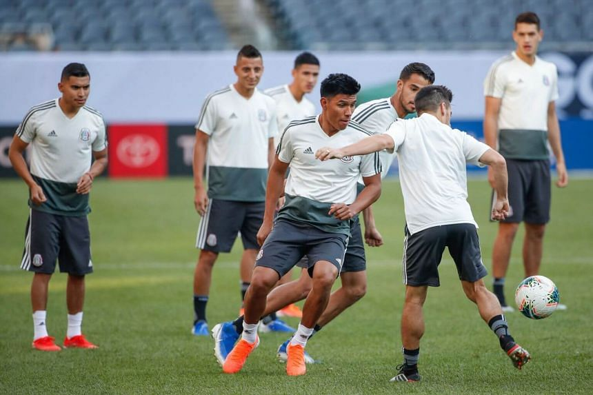 Mexico's players warm up during a training session at Soldier Field in Chicago, Illinois, on July 6, 2019.