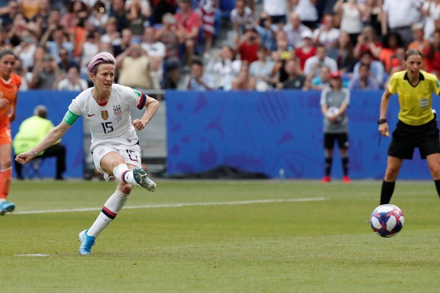 Megan Rapinoe of the US scores their first goal from the penalty spot during the France 2019 Women's World Cup football final match against the Netherlands, at the Lyon Stadium, on July 7, 2019.