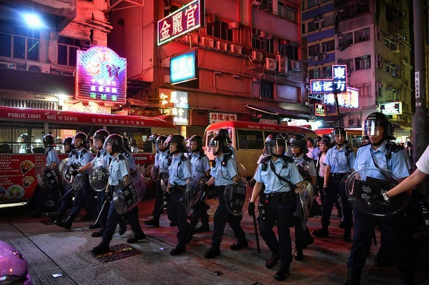 Hong Kong police in the city's Mong Kok area on July 7, 2019. Six people were arrested for assaulting and obstructing a police officer when action was taken to disperse protesters.