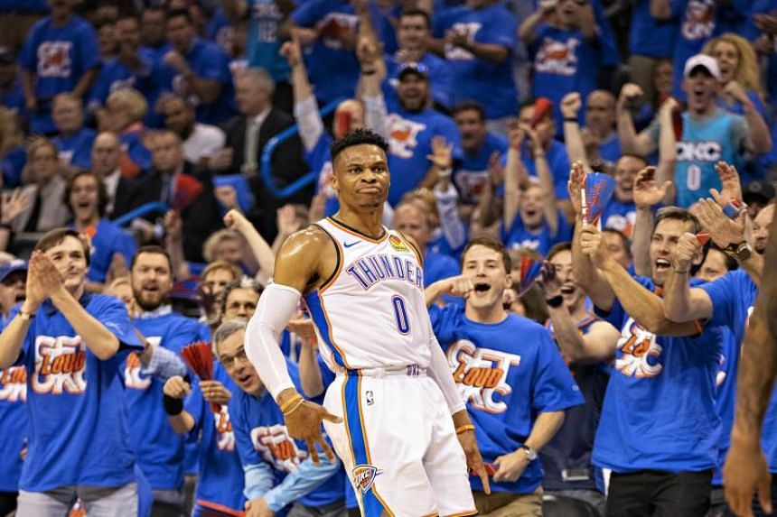 Russell Westbrook of the Oklahoma City Thunder celebrates after making a three point shot during a game against the Portland Trail Blazers during Round One Game Three of the 2019 NBA Playoffs on April 21, 2019.