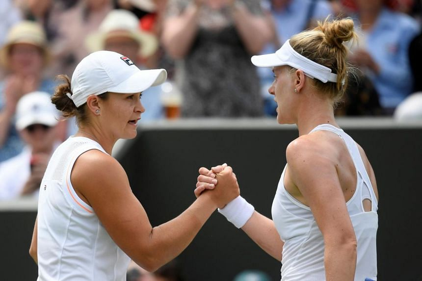 Australia's Ashleigh Barty (left) shakes hands with Alison Riske of the US after their fourth round match at the All England Lawn Tennis and Croquet Club, London, Britain on July 8, 2019.