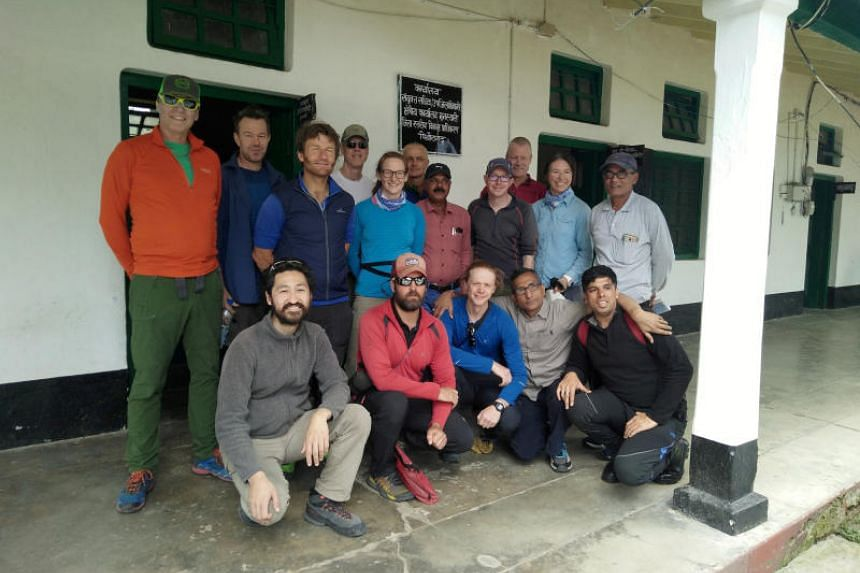The climbers pose for a picture before leaving for their expedition in Munsiyari town in the northern Himalayan state of Uttarakhand, India, on May 13, 2019.