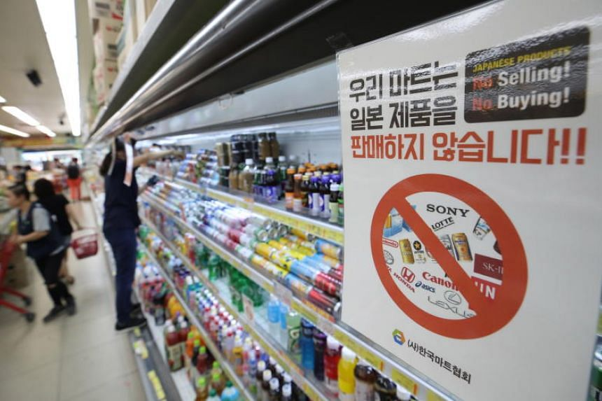 A retail outlet posts a notice stating that is neither selling nor buying Japanese products amid signs of the spreading of a boycott campaign, in Seoul on July 5, 2019.