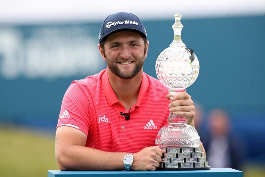 Spain's Jon Rahm poses with the trophy after winning the 2019 Irish Open on July 7, 2019.