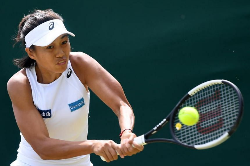 China's Zhang Shuai during the fourth round match for the Wimbledon Championships at the All England Lawn Tennis Club, in London on July 8, 2019.