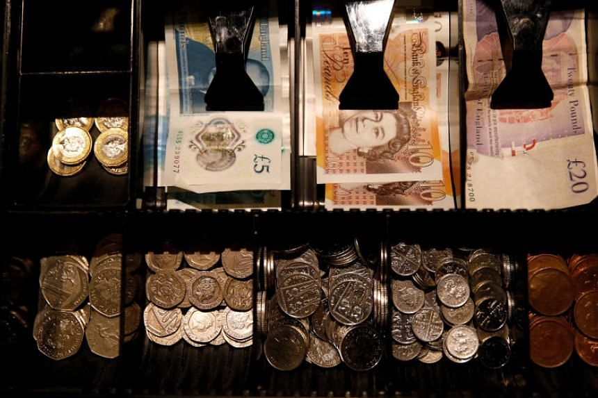 Sterling Pounds seen inside a cash register in a coffee shop in Manchester, on Sept 21, 2018.