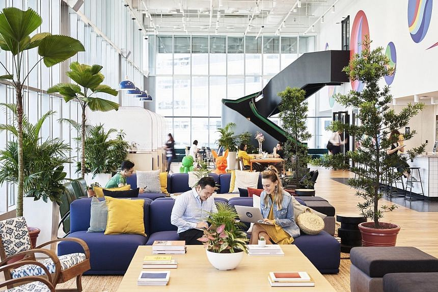 """Above: Mr Adam Neumann, co-founder and chief executive of WeWork, which has helped pioneer """"co-working"""" or shared desk space. Right: New York-based WeWork's outlet at Suntec City Tower 5. PHOTO: WEWORK"""