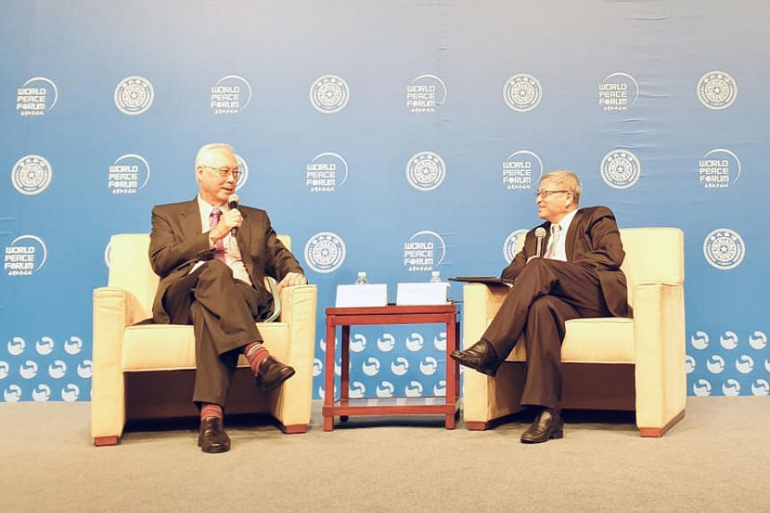 Emeritus Senior Minister Goh Chok Tong with Professor Yan Xuetong, session moderator and dean of Tsinghua University's Institute of International Relations, at the university's annual World Peace Forum in Beijing on July 9, 2019.