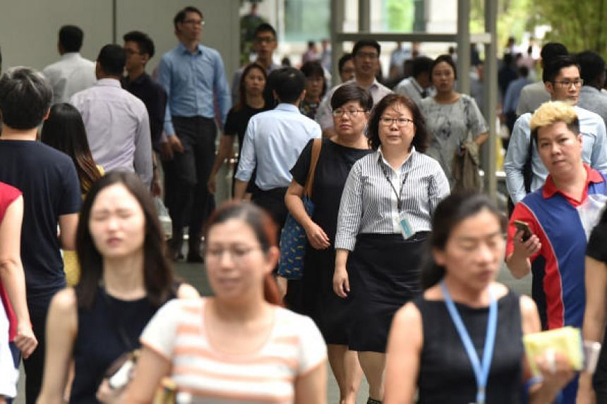 Besides covering more workers, last year's update to the Employment Act also addressed the rise of freelancers in the gig economy. PHOTOS: ST FILE, AFP, HUSH TEABAR