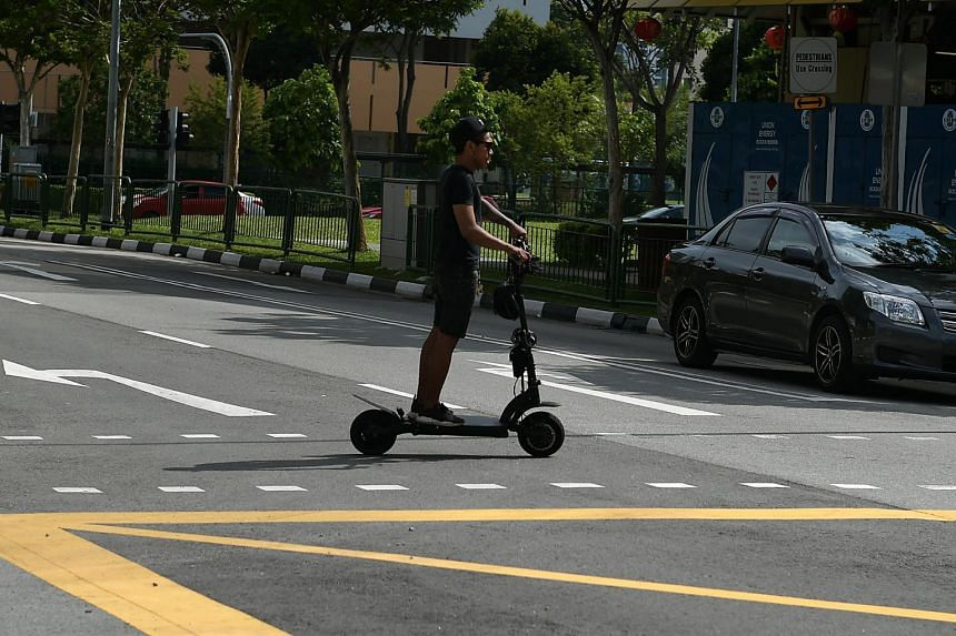 A man on an e-scooter riding along Old Airport Road on Feb 4, 2018.