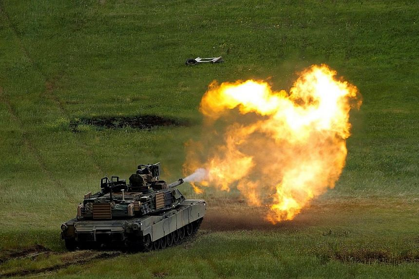 An M1A2 Abrams tank firing in a US-led joint military exercise in Georgia in 2016. The US Defence Security Cooperation Agency said the arms deal with Taiwan includes 108 M1A2T Abrams tanks, 250 Stinger portable anti-aircraft missiles and related equi