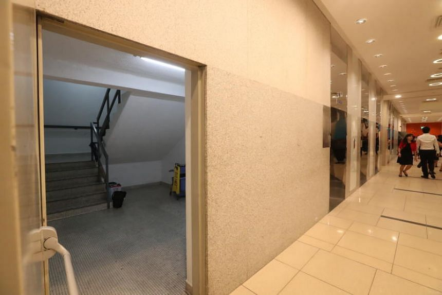 A staircase that leads to the lift landing at level one in International Plaza.