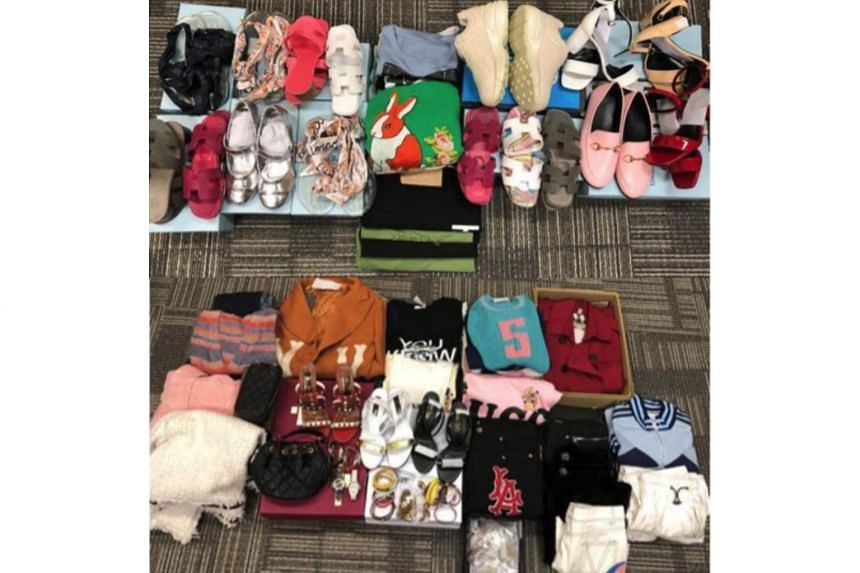 More than 500 pieces of trademark-infringing goods - such as footwear, watches, bags, caps and accessories - were seized during the raids.