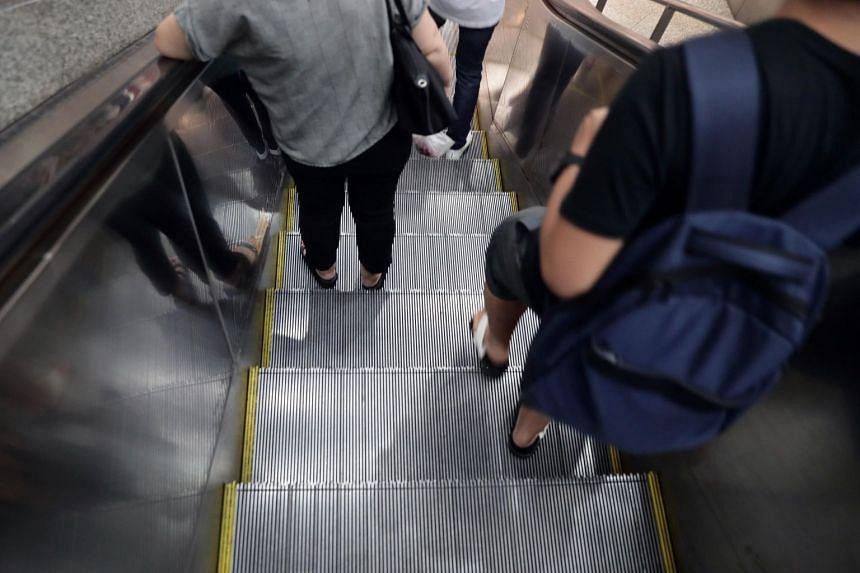 Commuters on an escalator of an MRT station, on June 23, 2019.