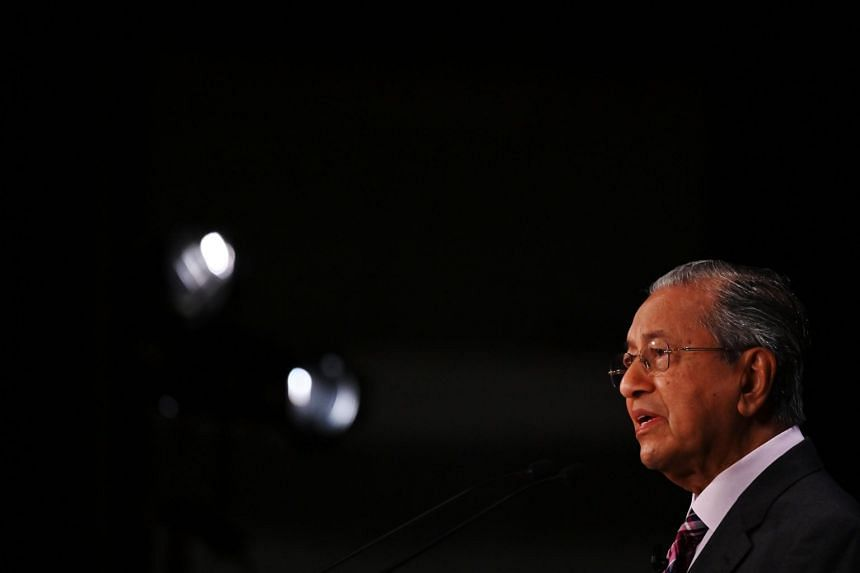 Malaysia's Prime Minister Mahathir Mohamad (above) held a closed-door meeting with parliamentary heads of Umno, the fundamentalist Parti Islam SeMalaysia and Gabungan Parti Sarawak, to lock in their support, in return for meeting their stipulated con