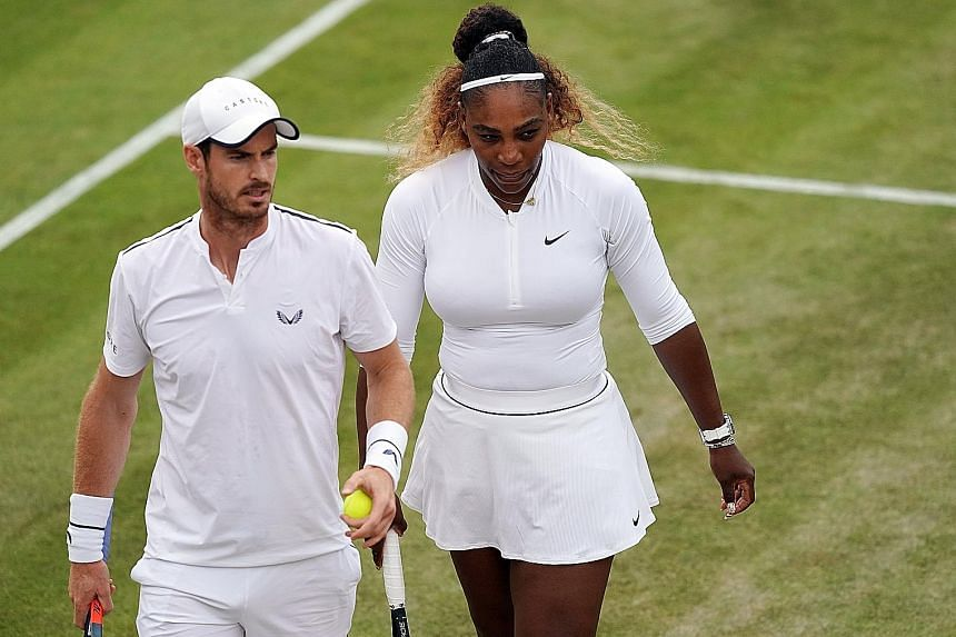 Andy Murray and Serena Williams during their third-round mixed doubles loss to top seeds Bruno Soares and Nicole Melichar yesterday.
