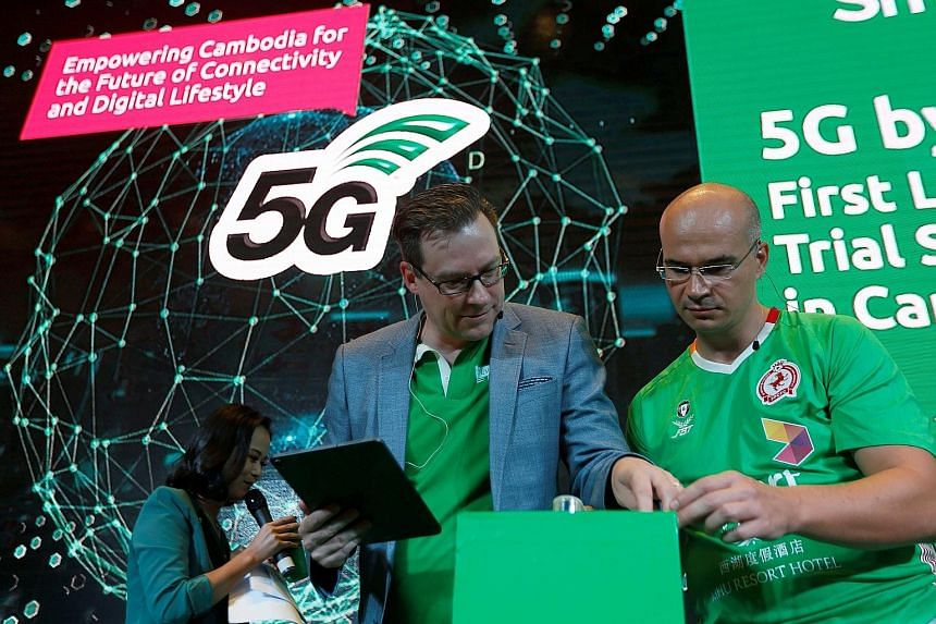 Smart Axiata chief executive Thomas Hundt (centre) at a 5G launch ceremony in Phnom Penh, Cambodia, on Monday. He says Smart Axiata will probably invest hundreds of millions of dollars over the next few years in 5G mobile networks, but it will need t