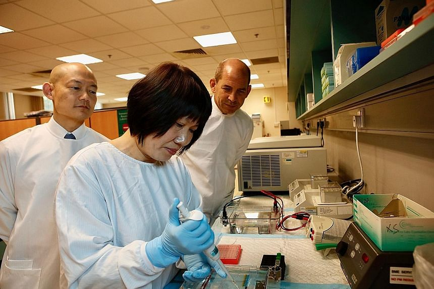 Genome Institute of Singapore's Professor Swaine Chen (left) and Tan Tock Seng Hospital's principal medical technologist Tang Wen Ying are part of the research team that studied the ST283 strain, with principal lead investigator Timothy Barkham.