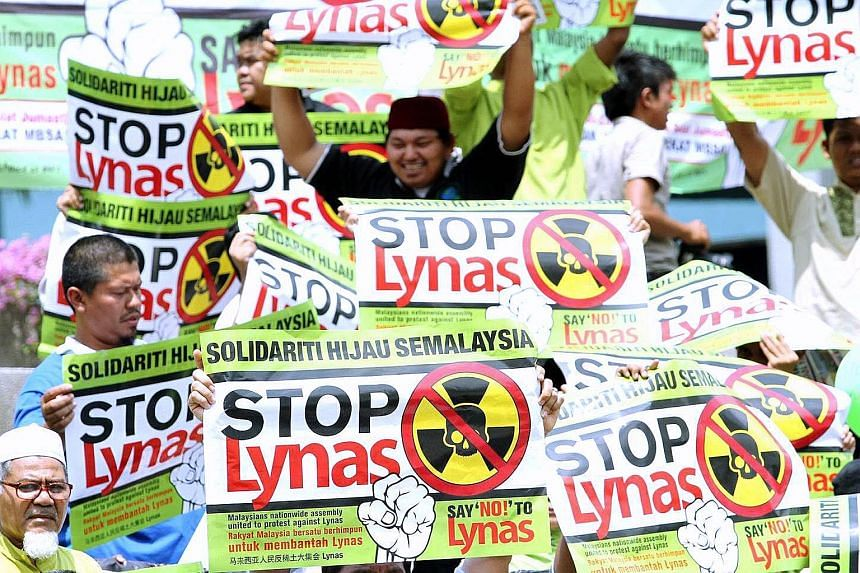 Activists campaigning in Shah Alam against the construction of a Lynas rare earth plant in April 2012. Rallies were held in 11 cities, including Kuantan where the plant is sited. Despite the protests, the plant opened at the end of the year. PHOTO: T