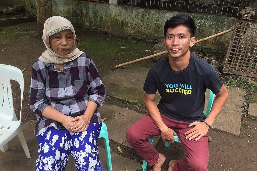 Filipino suicide bomber Norman Lasuca, 23, with his mother Vilman Lasuca, who came forward to claim his remains on July 1. Tissue samples taken from both of them for DNA testing confirmed that he was her son. PHOTO: ARMED FORCES OF THE PHILIPPINES
