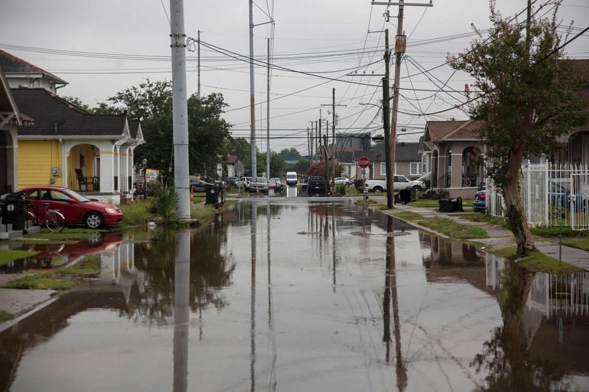 Many New Orleans streets were flooded after parts of the city received more than 20cm of rain.