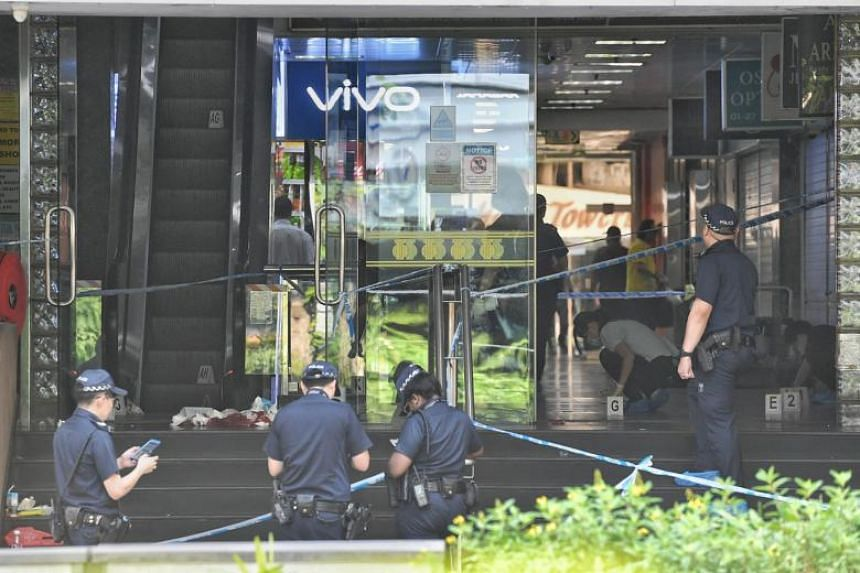 Several police officers seen gathering evidence near Orchard Towers' entrance, which was cordoned off, when The Straits Times arrived at the scene at about 11am on July 2, 2019.