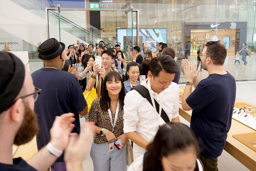 Apple staff welcoming media during a sneak preview of the Apple Store in Jewel Changi Airport. Expect the same during the grand opening on July 13, 10am.