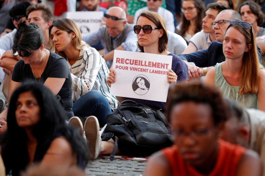 People demonstrate in support of French quadriplegic Vincent Lambert in Paris, France, on July 10, 2019.