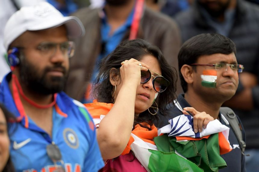 India's fans react at the end of play against New Zealand.