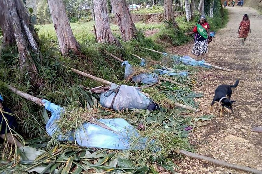 Bodies lined up on a road in Hela province in Papua New Guinea.